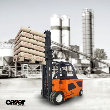 A Carer electric forklift lifting a pallet of cement bags in a yard.