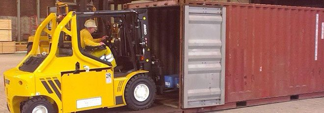 Carer's high capacity K-series forklift loading a shipping container